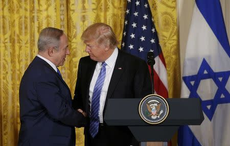 U.S. President Donald Trump (R) greets Israeli Prime Minister Benjamin Netanyahu at a joint news conference at the White House in Washington, U.S., February 15, 2017.   REUTERS/Kevin Lamarque