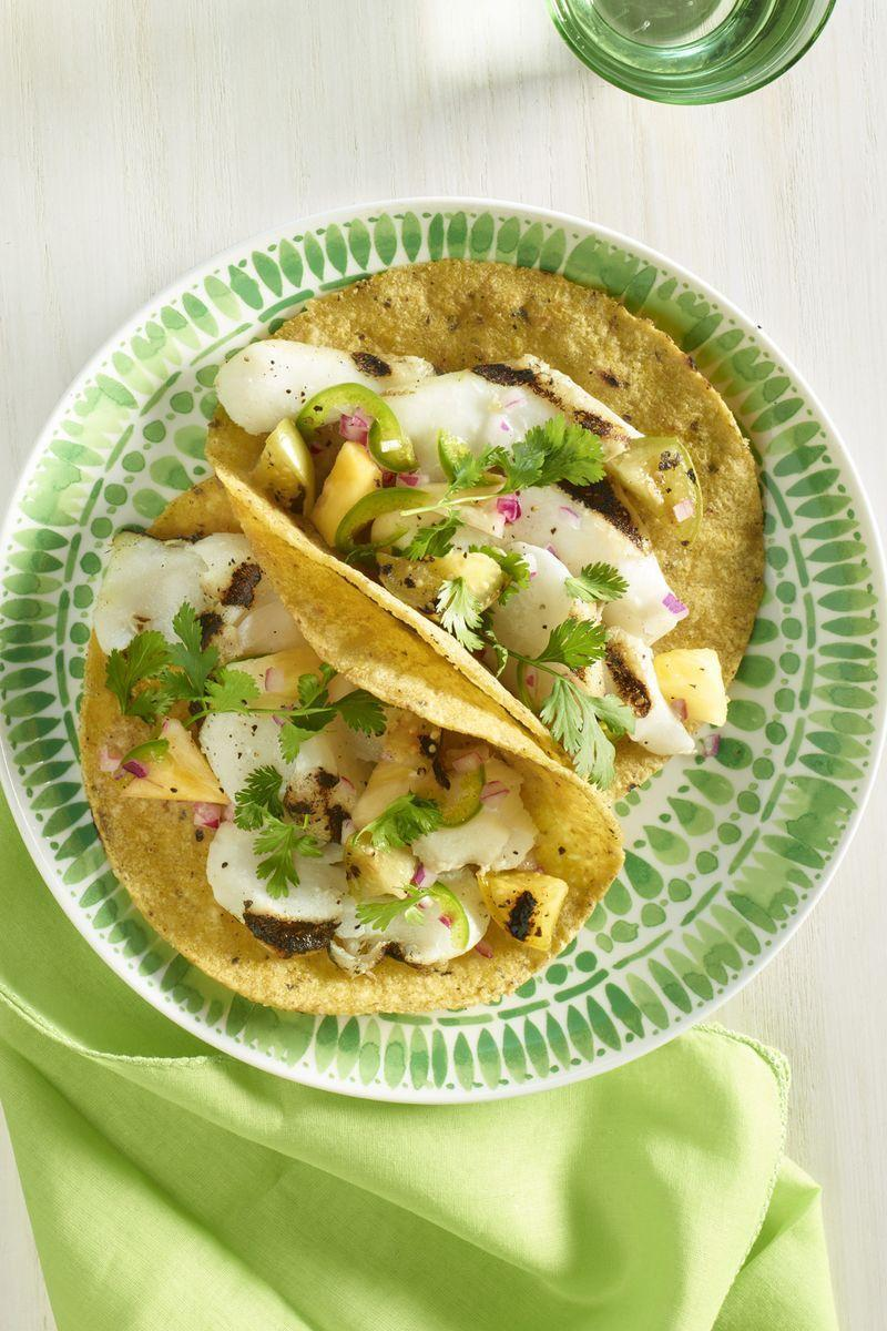"""<p>Grilled tilapia (cod or halibut work too!) tastes even better in a grilled tortilla with tomatillo and pineapple toppings.</p><p><a href=""""https://www.womansday.com/food-recipes/food-drinks/recipes/a59766/grilled-fish-tacos-recipes/"""" rel=""""nofollow noopener"""" target=""""_blank"""" data-ylk=""""slk:Get the recipe for Grilled Fish Tacos."""" class=""""link rapid-noclick-resp""""><em>Get the recipe for Grilled Fish Tacos.</em></a></p>"""