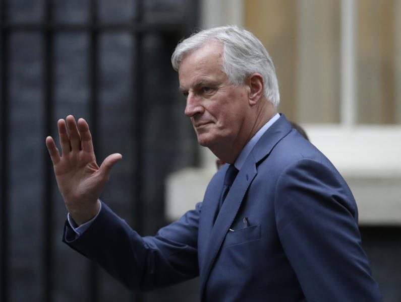 EU Chief Negotiator on Brexit Michael Barnier waves to the media as he arrives for a meeting with Britain's Prime Minister Boris Johnson and European Commission President Ursula von der Leyen in 10 Downing Street in London, Wednesday, Jan. 8, 2020. (AP Photo/Matt Dunham)