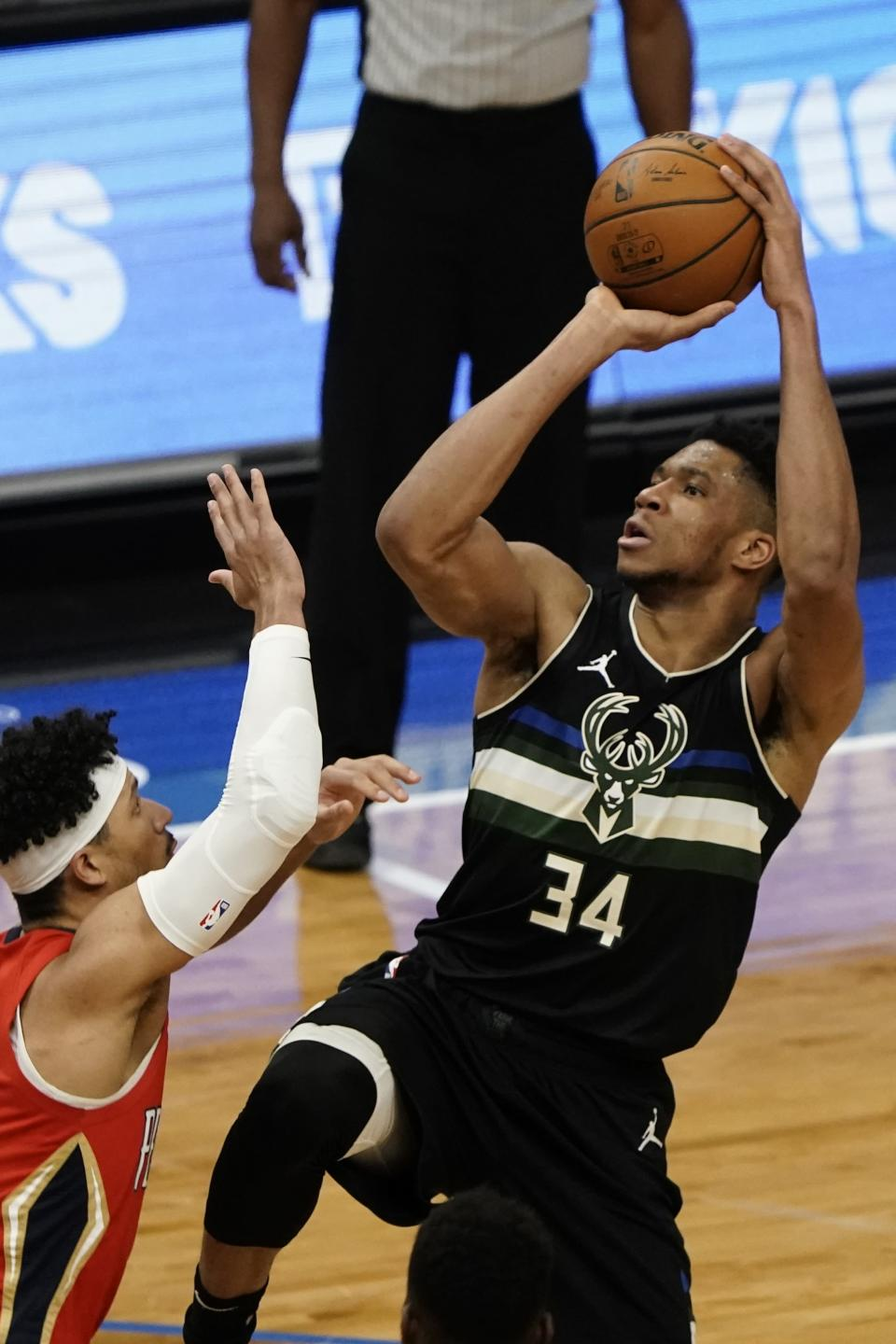 Milwaukee Bucks' Giannis Antetokounmpo shoots over New Orleans Pelicans' Josh Hart during the second half of an NBA basketball game Thursday, Feb. 25, 2021, in Milwaukee. (AP Photo/Morry Gash)