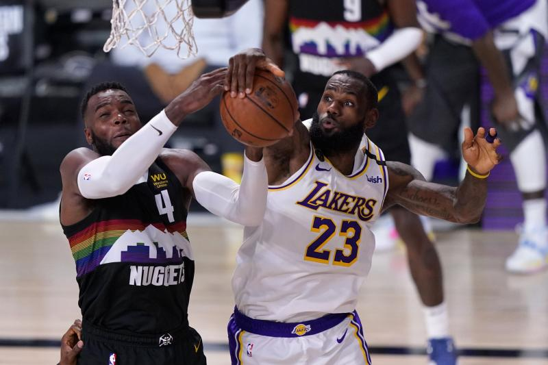 Denver Nuggets forward Paul Millsap (4) has his shot blocked by Los Angeles Lakers' LeBron James (23) during the second half of Game 3 of the NBA basketball Western Conference final Tuesday, Sept. 22, 2020, in Lake Buena Vista, Fla. (AP Photo/Mark J. Terrill)