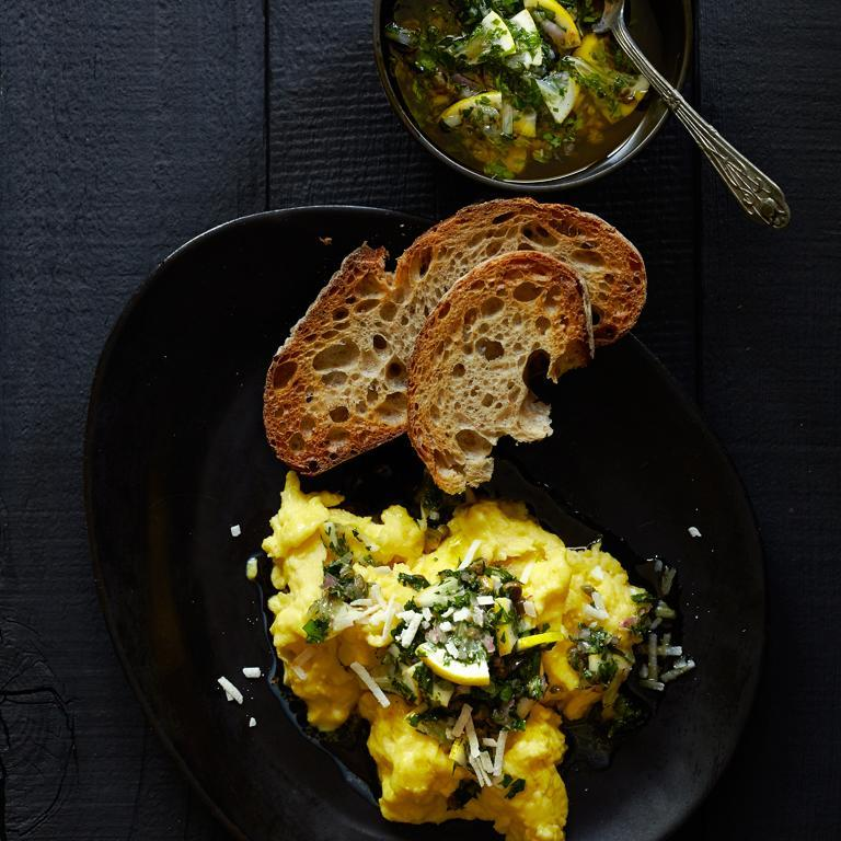 """<p>The combination of a vibrant Italian-style sauce and three robust cheeses makes these <a href=""""https://www.myrecipes.com/extracrispy/make-the-creamiest-scrambled-eggs-ever-with-this-trick"""" rel=""""nofollow noopener"""" target=""""_blank"""" data-ylk=""""slk:scrambled eggs"""" class=""""link rapid-noclick-resp"""">scrambled eggs</a> nothing short of spectacular. The recipe comes from chef-owners Gayle Pirie and John Clark of <a href=""""http://foreigncinema.com/"""" rel=""""nofollow noopener"""" target=""""_blank"""" data-ylk=""""slk:Foreign Cinema"""" class=""""link rapid-noclick-resp"""">Foreign Cinema</a> in San Francisco.</p>"""