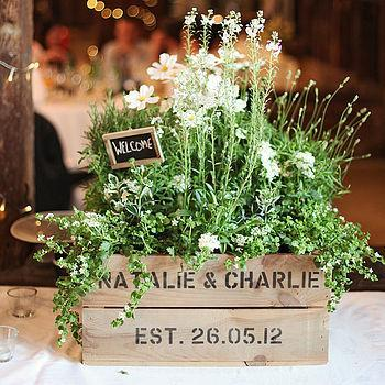 old crate repurposed in to a wedding centerpiece