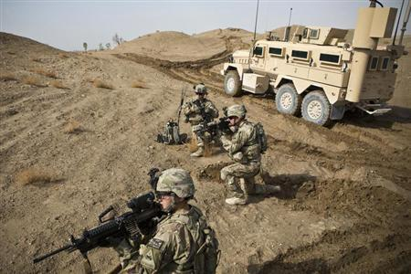 U.S. Army soldiers with Charlie Company, 36th Infantry Regiment, 1st Armored Division set up a supportive position during a mission near Command Outpost Pa'in Kalay in Maiwand District, Kandahar Province