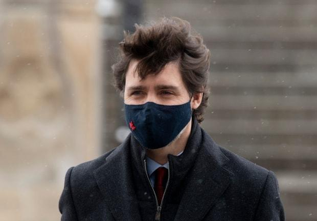 Prime Minister Justin Trudeau makes his way to a news news conference in Ottawa, Friday, Feb. 19, 2021. THE CANADIAN PRESS/Adrian Wyld
