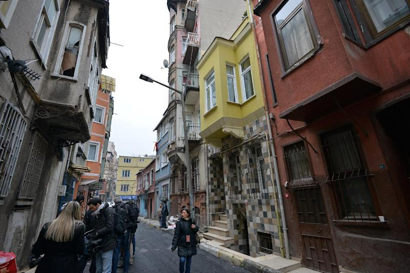 A view of the street with the hostel, in yellow, where Sarai Sierra, a New York City woman, 33, was staying in Istanbul, Turkey, Monday, Jan. 28, 2013. Police in Istanbul were scanning security camera footage Monday to try to trace Sierra who went missing while vacationing alone in the city, a Turkish official said. A police official said authorities were reviewing footage from around Istanbul's Taksim neighborhood _ the city's main hub where she was staying at a hostel.(AP Photo)