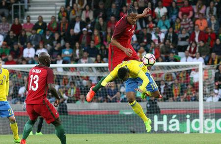Portugal's Bruno Alves in action against Sweden's Kiese Thelin. REUTERS/Duarte Sa