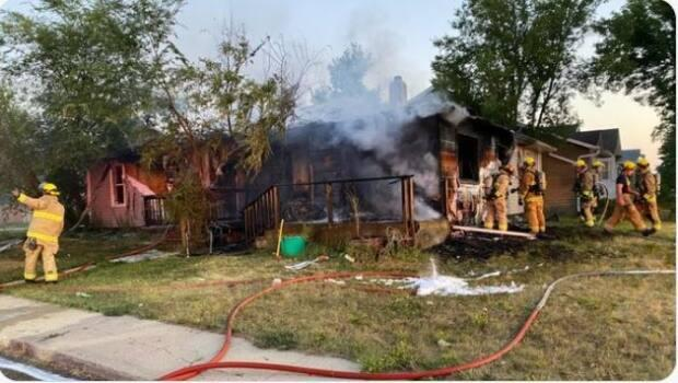 Firefighters on the scene of a Regina duplex fire over the weekend. (Regina Fire Department - image credit)