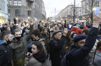 People light their cell phones during a protest in support of jailed opposition leader Alexei Navalny in Moscow, Russia, Wednesday, April 21, 2021. Human rights groups say police across Russia have arrested more than 180 people in connection with demonstrations supporting imprisoned opposition leader Alexei Navalny. Many were seized before protests even began, including two top Navalny associates in Moscow. (AP Photo/Denis Kaminev)