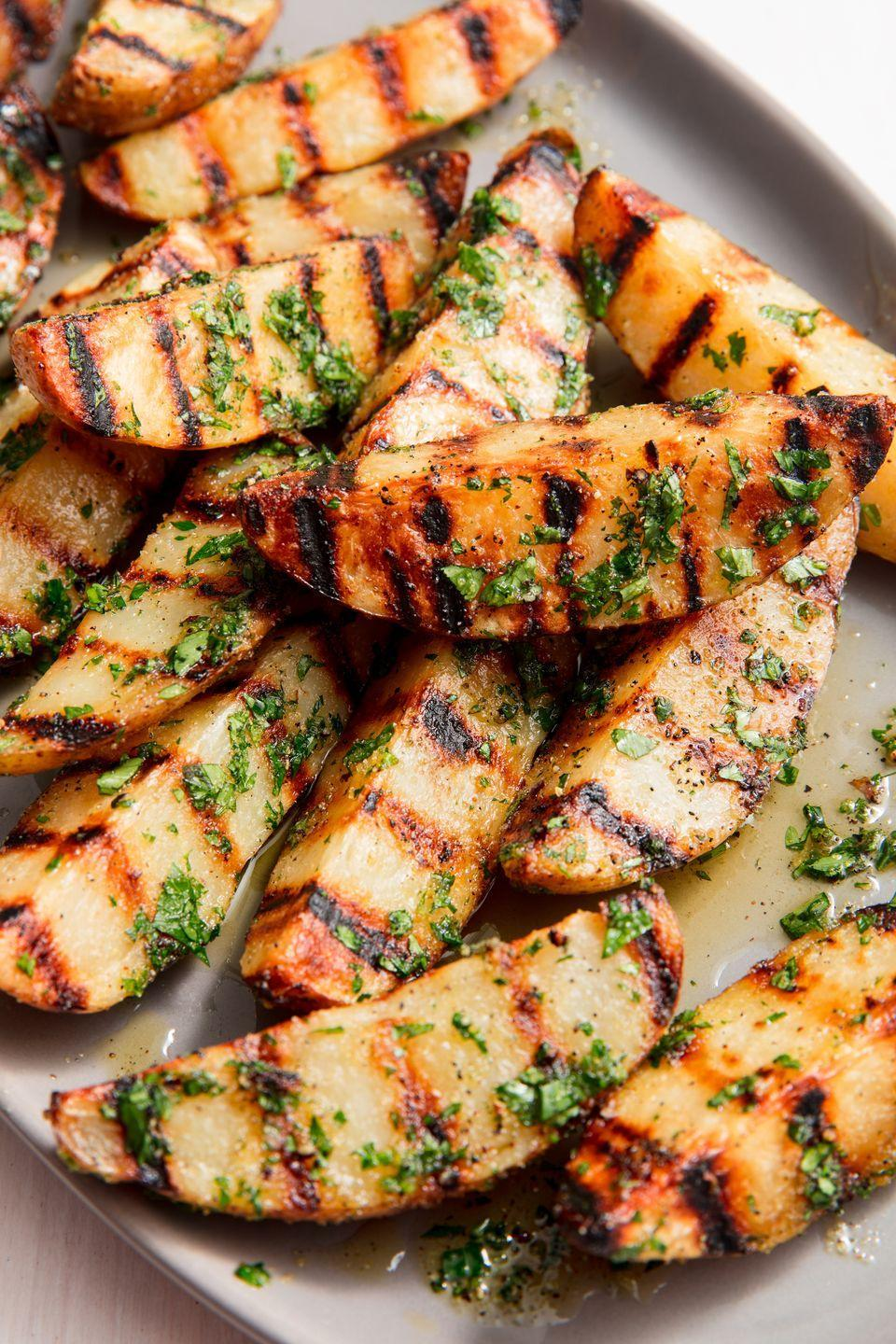 """<p>If you've never thought to grill potatoes before, get ready. The spuds get crispy on the outside and stay creamy on the inside.</p><p>Get the recipe from <a href=""""https://www.delish.com/cooking/recipe-ideas/a20164811/best-grilled-potatoes-recipe/"""" rel=""""nofollow noopener"""" target=""""_blank"""" data-ylk=""""slk:Delish"""" class=""""link rapid-noclick-resp"""">Delish</a>. </p>"""