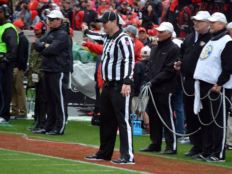 Among the numerous pre-snap responsibilities of the line judge: signaling to the other officials that the widest receiver is not on the line of scrimmage. | Gary McGriff/Southeastern Conference