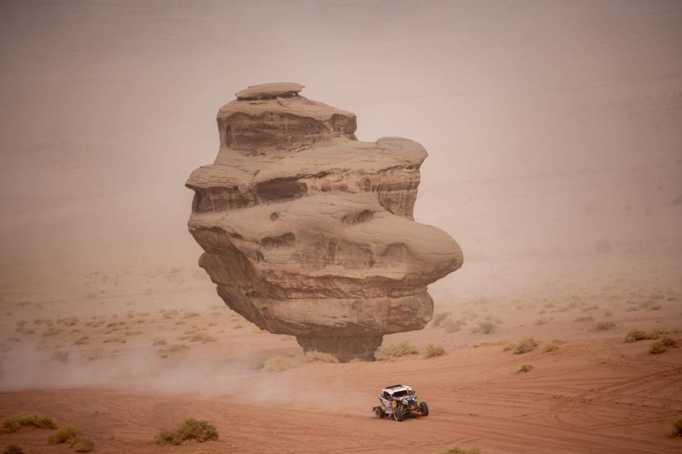 <em>Francisco Chaleco Lopez races past a rock formation during Stage 10 (Marcelo Maragni/Red Bull Content Pool).</em>