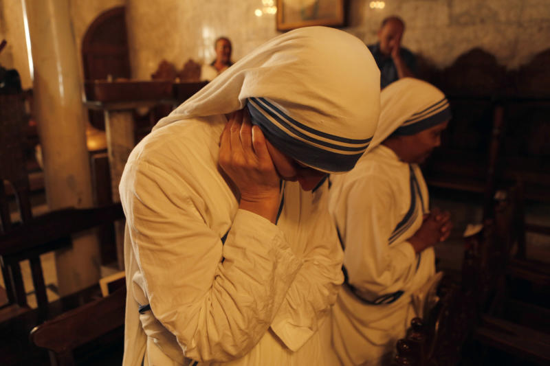 Missionaries of Charity nuns attend a religious service as part of the funeral of Jalila Ayyad, a Christian woman whose body was found under the rubble of her home after an Israeli air strike, on July 27, 2014 in Gaza City (AFP Photo/Mohammed Abed)