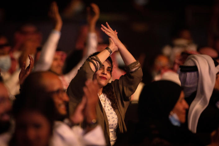 In this July 8, 2021 photo, a coronavirus vaccinated audience cheers as Saudi prominent singer Mohammed Abdu performs at the newly built Super Dome, in Jiddah, Saudi Arabia. The concert is organized by the Saudi General Entertainment Authority after the kingdom lifted coronavirus restrictions on events in May. (AP Photo/Amr Nabil)