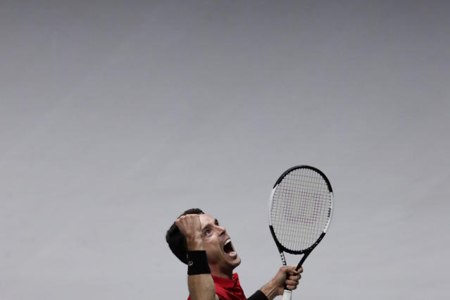 Spain's Roberto Bautista Agut reacts after defeating Canada's Felix Auger-Aliassime 7/6, 6/3 in their their tennis singles match of the Davis Cup final in Madrid, Spain, Sunday, Nov. 24, 2019. (AP Photo/Bernat Armangue)