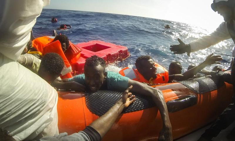 Migrants are pulled aboard a rescue craft after a boat carrying more than 500 people capsized off Lampedusa last week.