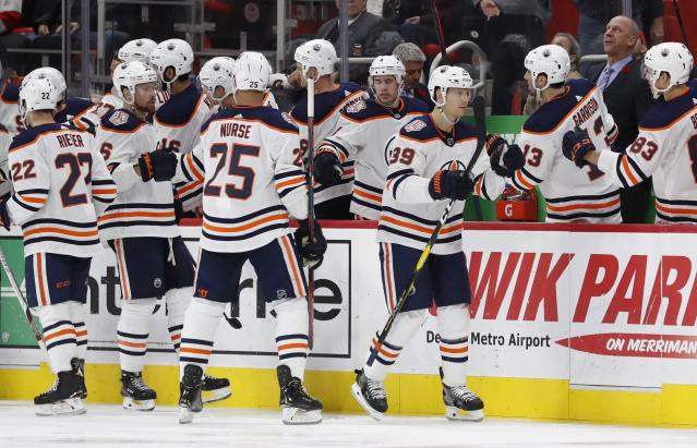 Edmonton Oilers right wing Alex Chiasson (39) fist bumps teammates after scoring during the second period of an NHL hockey game against the Detroit Red Wings, Saturday, Nov. 3, 2018, in Detroit. (AP Photo/Carlos Osorio)