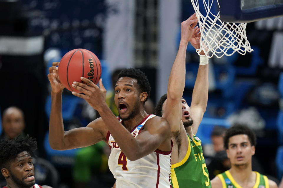 Southern California forward Evan Mobley (4) grabs a rebound in front of Oregon guard Chris Duarte (5) during the first half of a Sweet 16 game in the NCAA men's college basketball tournament at Bankers Life Fieldhouse, Sunday, March 28, 2021, in Indianapolis. (AP Photo/Jeff Roberson)