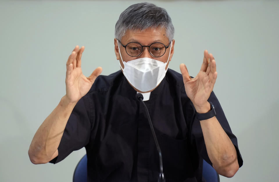 Stephen Chow Sau-yan gestures during a press conference in Hong Kong Tuesday, May 18, 2021. Pope Francis on Monday named a new bishop for Hong Kong, tapping the head of his own Jesuit order in the region, the Rev. P. Stephen Chow Sau-Yan, for the politically sensitive position that has been vacant for two years. (AP Photo/Vincent Yu)