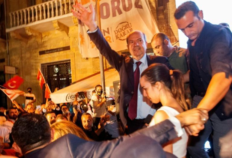 Turkish Cypriot right-wing leader Ersin Tatar (C) celebrates with supporters in northern Nicosia after winning the presidential election in the self-declared Turkish Republic of Northern Cyprus