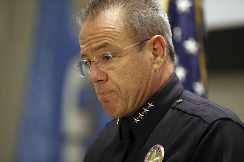 The LAPD chief, Michel Moore, speaks at a news conference.