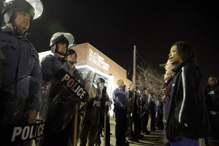 Police and protesters square off outside the Ferguson Police Department the night two officers were shot amid the demonstrations. (AP/Jeff Roberson)