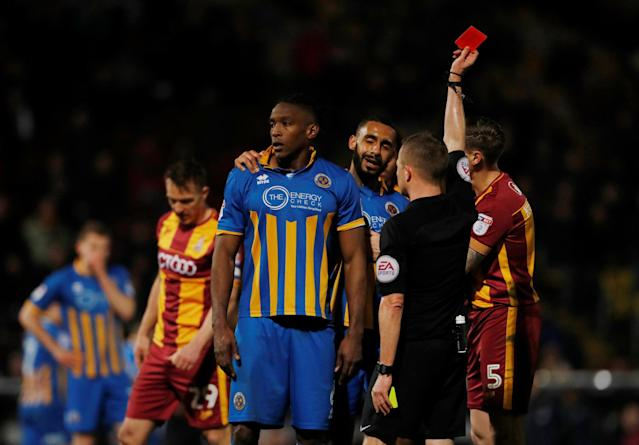 "Soccer Football - League One - Bradford City vs Shrewsbury Town - Northern Commercials Stadium, Bradford, Britain - April 12, 2018 Shrewsbury's Omar Beckles is shown a red card by referee David Webb Action Images/Lee Smith EDITORIAL USE ONLY. No use with unauthorized audio, video, data, fixture lists, club/league logos or ""live"" services. Online in-match use limited to 75 images, no video emulation. No use in betting, games or single club/league/player publications. Please contact your account representative for further details."