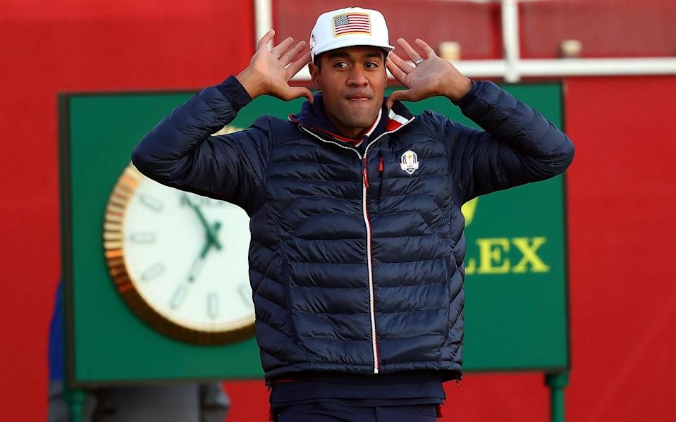 Tony Finau tries to gee up the crowd at the start of day one - GETTY IMAGES