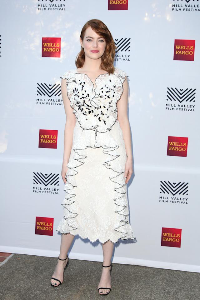 <p>The actress selected a ruffled dress from Rodarte for the festival's opening night. <i>[Photo: Getty]</i></p>