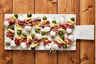 """<p>Fresh tortellini makes this the hearty <a href=""""https://www.delish.com/food/g2168/bite-size-appetizers/"""" rel=""""nofollow noopener"""" target=""""_blank"""" data-ylk=""""slk:party appetizer"""" class=""""link rapid-noclick-resp"""">party appetizer</a> of our dreams.<br></p><p>Get the recipe from <a href=""""https://www.delish.com/cooking/recipe-ideas/recipes/a48544/antipasto-bites-recipe/"""" rel=""""nofollow noopener"""" target=""""_blank"""" data-ylk=""""slk:Delish"""" class=""""link rapid-noclick-resp"""">Delish</a>.</p>"""