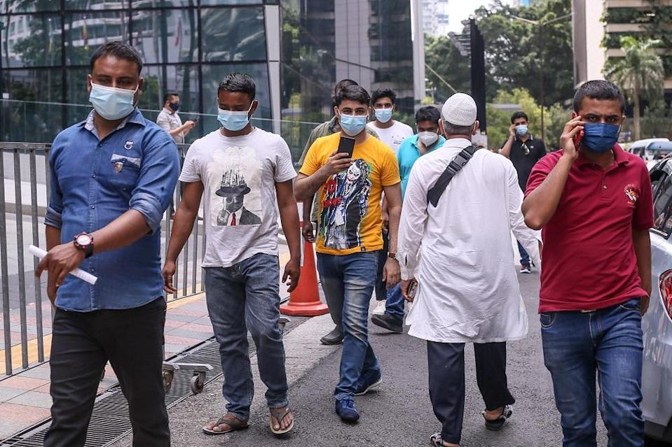 Foreign workers are seen at the KLCC vaccination centre to receive their Covid-19 jab July 27, 2021. — Picture by Ahmad Zamzahuri