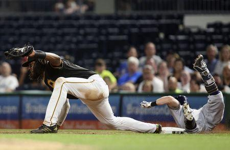 Jun 18, 2018; Pittsburgh, PA, USA; Pittsburgh Pirates first baseman Josh Bell (55) takes a throw to force out Milwaukee Brewers second baseman Eric Sogard (right) during the eighth inning at PNC Park. Pittsburgh won 1-0. Mandatory Credit: Charles LeClaire-USA TODAY Sports