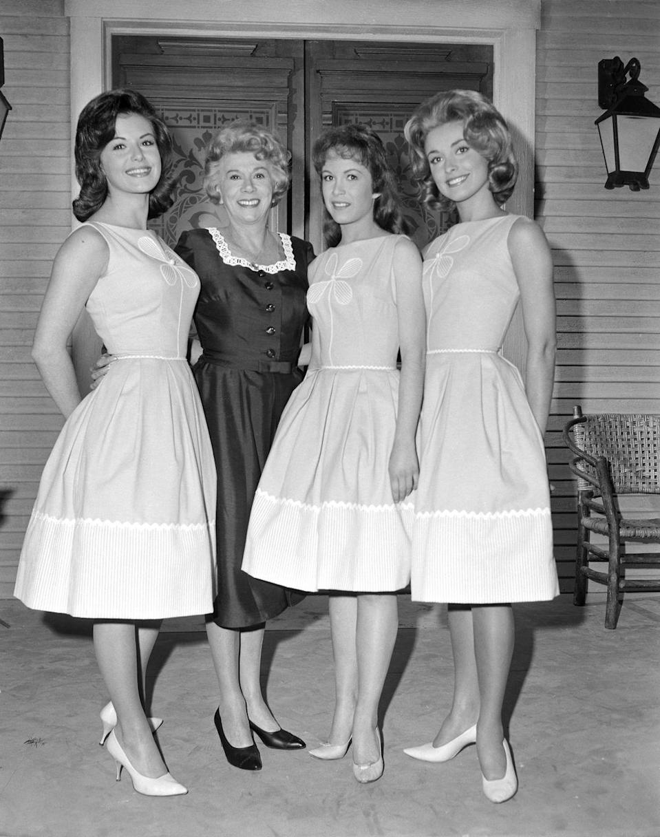 <p>Tate began auditioning for roles on various television shows. Here she is posing (far right) with the early cast of <em>Petticoat Junction</em> in 1963. Tate auditioned for the role of Billie Jo, but was not hired.  </p>