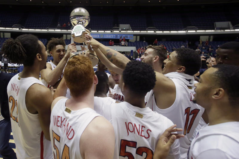 Arizona players hold the trophy after the team defeated Wake Forest 73-66 during the championship game of an NCAA college basketball game at the Wooden Legacy tournament in Anaheim, Calif., Sunday, Dec. 1, 2019. (AP Photo/Alex Gallardo)