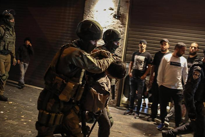 """Israeli security forces arrest a man during a demonstration against the planned eviction process for the Palestinians in the Sheikh Jarrah neighbourhood of Jerusalem, on May 7, 2021.<span class=""""copyright"""">Ilia Yefimovich—picture alliance/Getty Images</span>"""