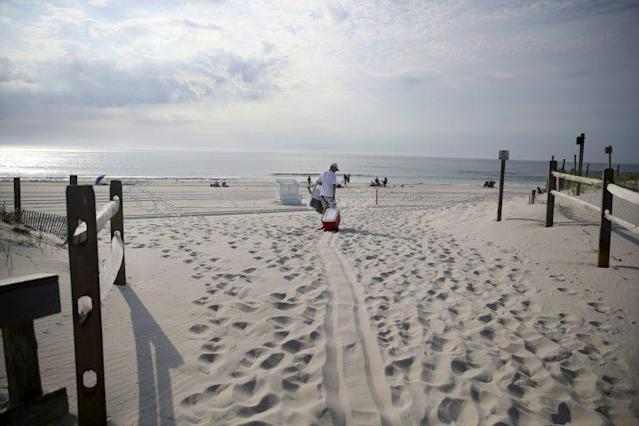 People arrive at the beach at Island Beach State Park in Seaside Park, N.J., after it reopened at 8 in the morning July 4. (Photo: Mel Evans/AP)