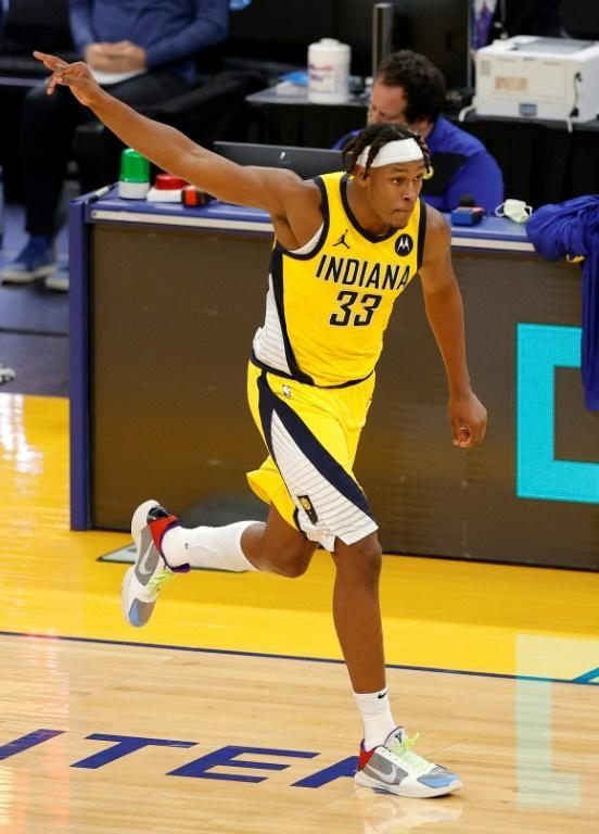 Indiana's Myles Turner reacts after making a three-pointer in the Pacers' 104-95 NBA victory over the Golden State Warriors