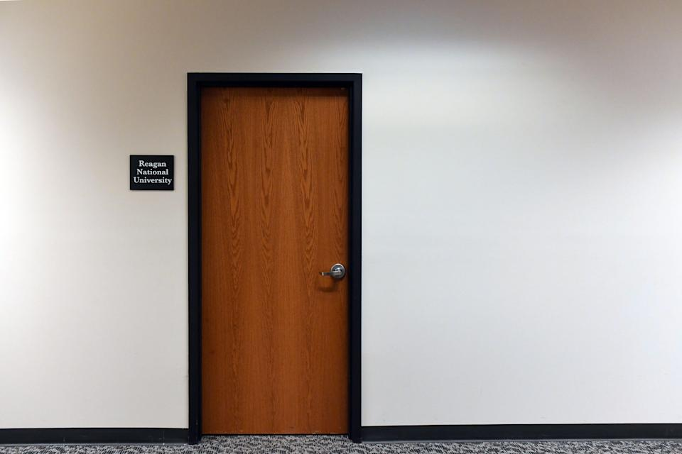 A sign for Reagan National University is posted outside one of two locked doors in the office building at 114 S. Main Ave on Jan. 29 in downtown Sioux Falls, S.D.