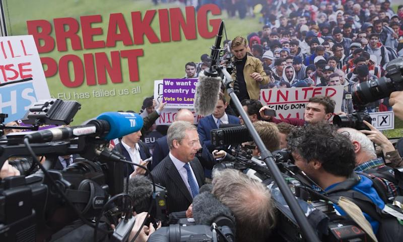 Nigel Farage in front of 'breaking point' poster