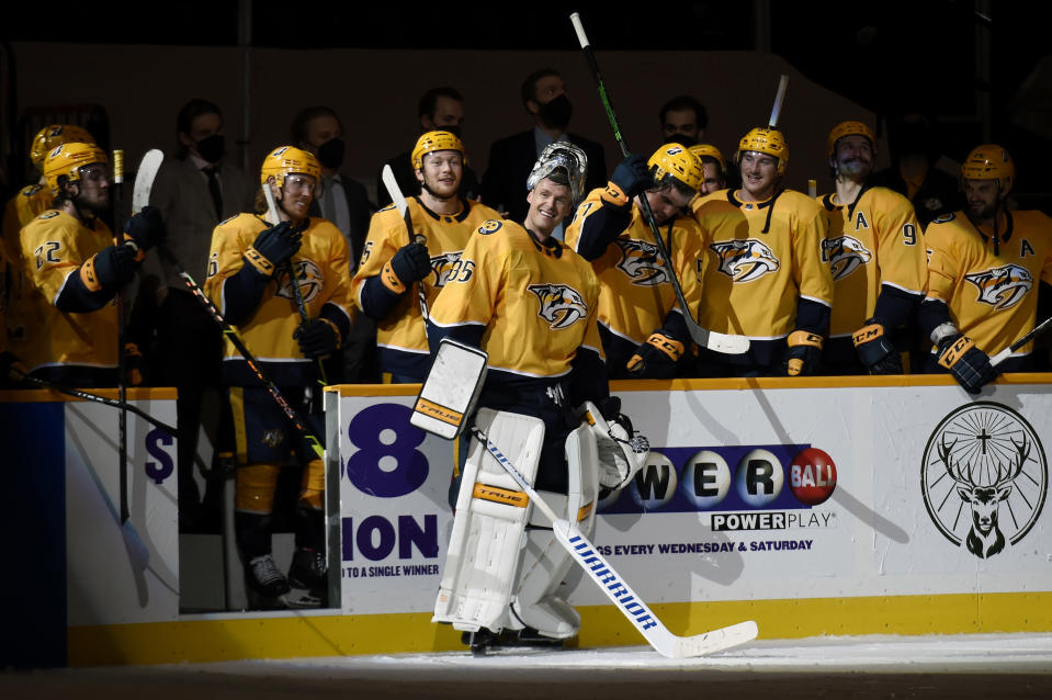 Nashville Predators goaltender Pekka Rinne (35) smiles as he receives a standing ovation from the crowd and his teammates after the Predators beat the Carolina Hurricanes in an NHL hockey game Monday, May 10, 2021, in Nashville, Tenn.(AP Photo/Mark Zaleski)