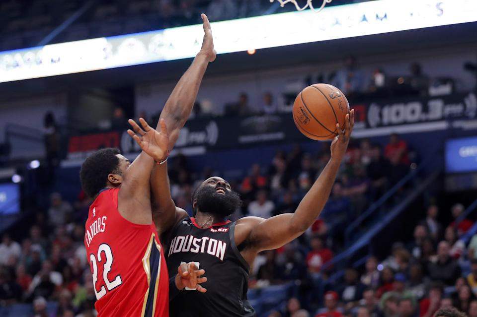 Houston Rockets guard James Harden goes to the basket against New Orleans Pelicans center Derrick Favors (22) in the first half of an NBA basketball game in New Orleans, Monday, Nov. 11, 2019. The Rockets won 122-116. (AP Photo/Gerald Herbert)