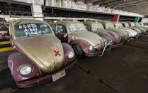 Old Volkswagen Beetles, once used as taxi cabs, in a yard for impounded cars in Mexico City on June 23, 2015 (AFP Photo/Omar Torres )