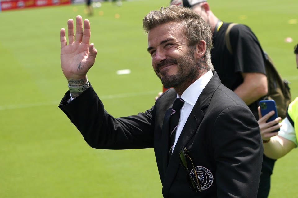 David Beckham, owner and president of soccer operations for Inter Miami, waves to fans before an MLS soccer match between Inter Miami, and LA Galaxy, Sunday, April 18, 2021, in Fort Lauderdale, Fla. (AP Photo/Lynne Sladky)