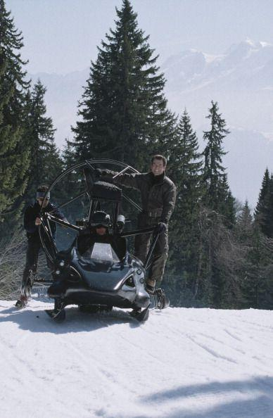 <p>Pierce Brosnan on a custom-built jet-propelled Flying Parahawk/Polaris Snowmobile, for 'The World Is Not Enough' on location in France, 1999. </p>