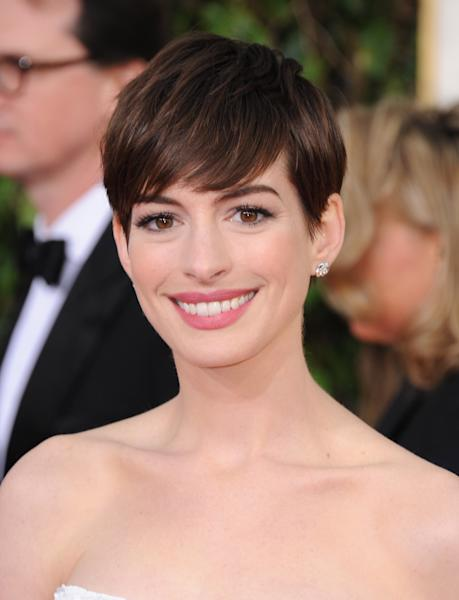 Actress Anne Hathaway arrives at the 70th Annual Golden Globe Awards at the Beverly Hilton Hotel on Sunday Jan. 13, 2013, in Beverly Hills, Calif. (Photo by Jordan Strauss/Invision/AP)