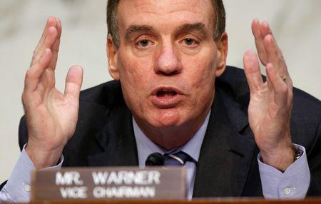 Senator Mark Warner (D-VA) questions witnesses about Russian interference in U.S. elections at the Senate Intelligence Committee in Washington, U.S., June 21, 2017.   REUTERS/Joshua Roberts