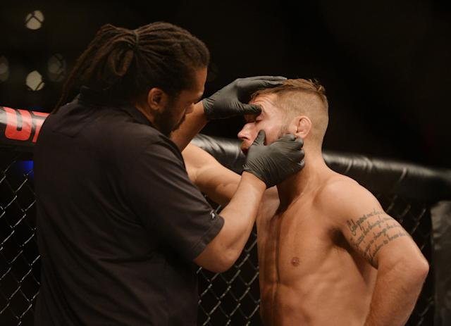 Referee Herb Dean checks the eyes of Jeremy Stephens during the fight against Yair Rodriguez (not pictured) during UFC Fight Night at Mexico City Arena. (Orlando Ramirez/USA Today Sports)