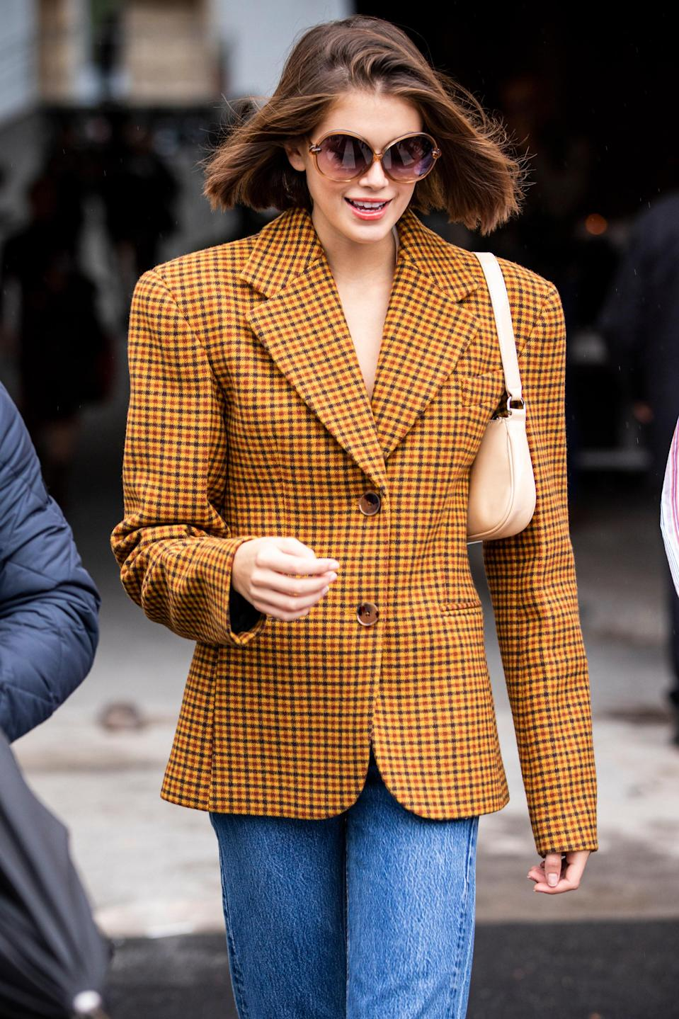But sometimes she switches it up with mini purses and structured blazers.