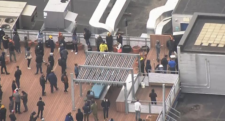A rooftop picture of employees waiting on a rooftop during an alleged hostage situation