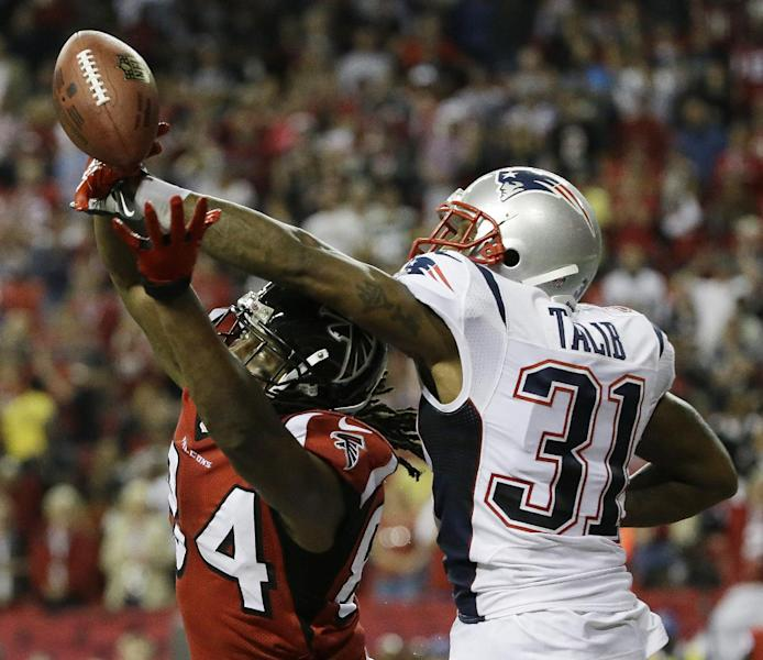 New England Patriots cornerback Aqib Talib (31) breaks up a pass intended for Atlanta Falcons wide receiver Roddy White (84) during the second half of an NFL football game, Sunday, Sept. 29, 2013, in Atlanta. The New England Patriots won 30-23. (AP Photo/David Goldman)